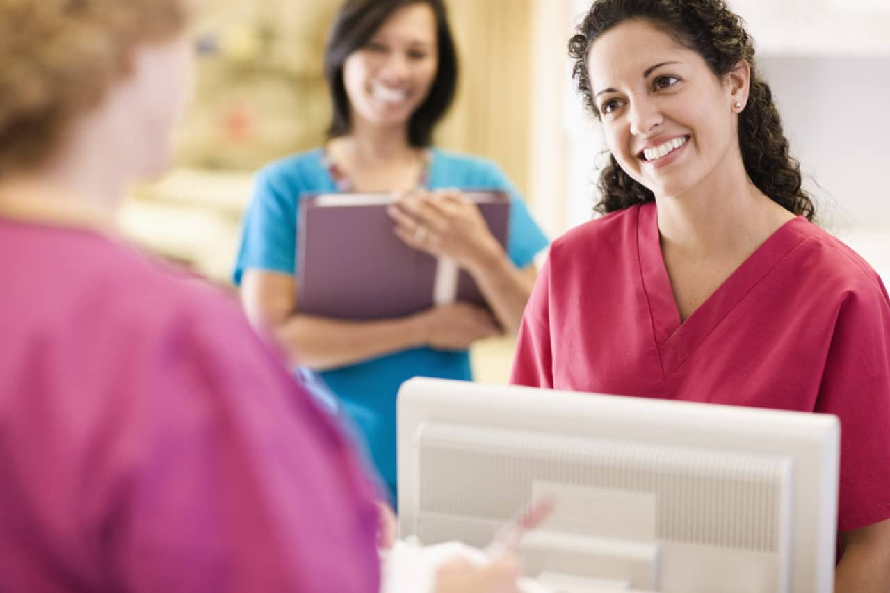 Photo of a staff member greeting a patient