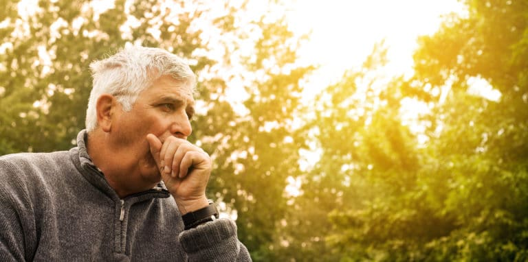 Coughing Senior Man on fresh air.