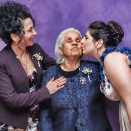 woman-kissing-woman-s-cheek
