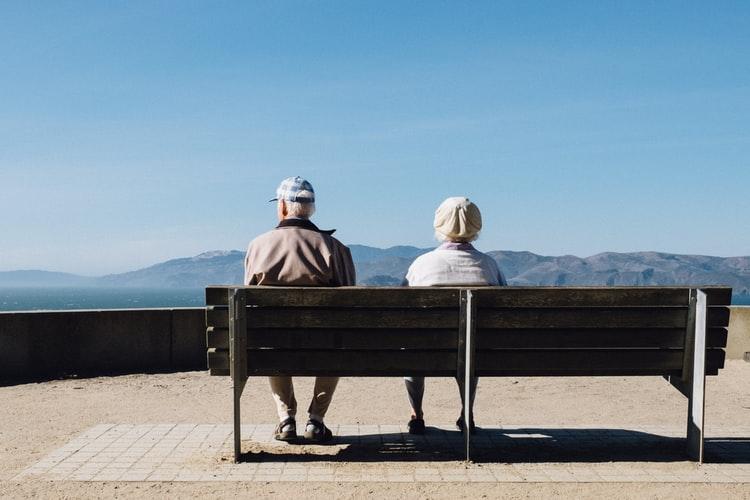 Seniors sitting at bench