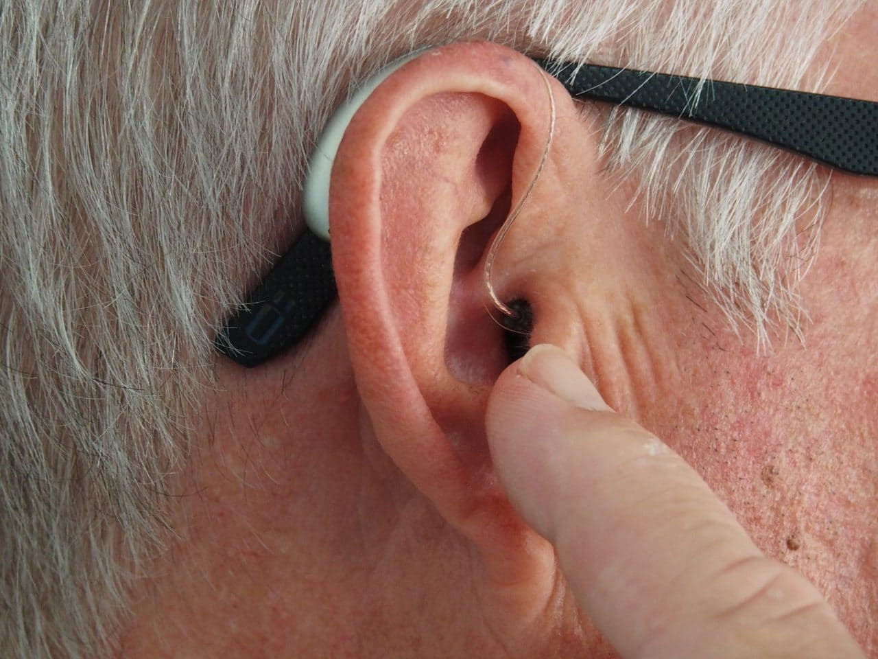 Close-up of a man's hearing aid