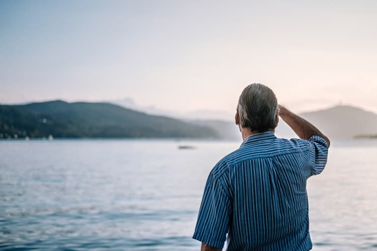 Man looks out at waterfront