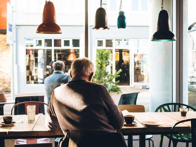 Man sitting inside coffee shop