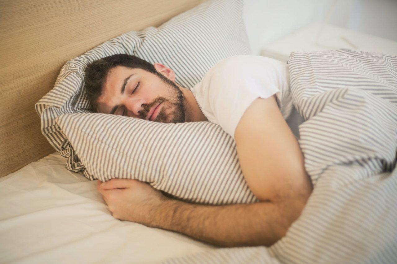 Man sleeping with pillow.