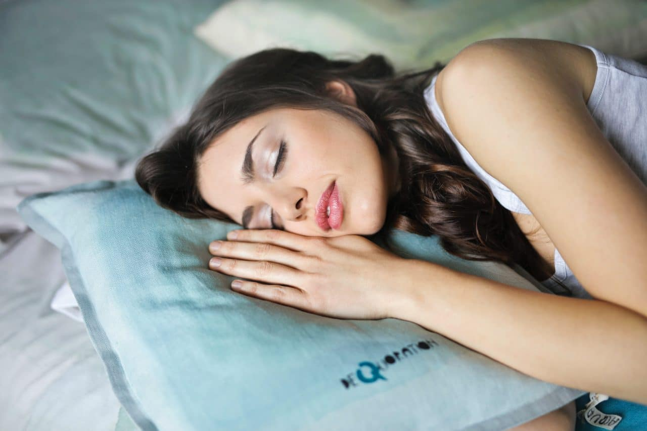 Woman sleeping on pillow.