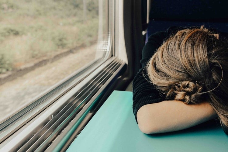 Woman falls asleep on train.