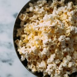 A bowl of popcorn on a table.
