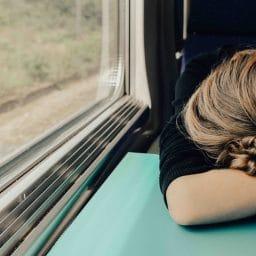 Woman falls asleep on a train.