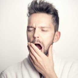 Man yawning.
